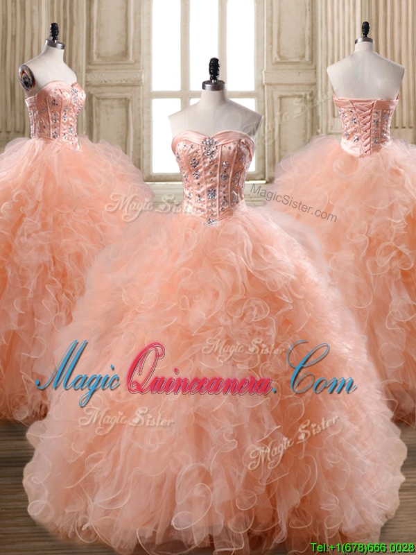 98497f258b3 Lovely Peach Big Puffy Quinceanera Dress with Beading and Ruffles. triumph