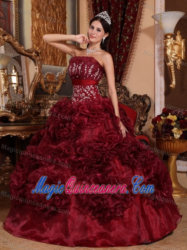 Burgundy and gold quinceanera dresses