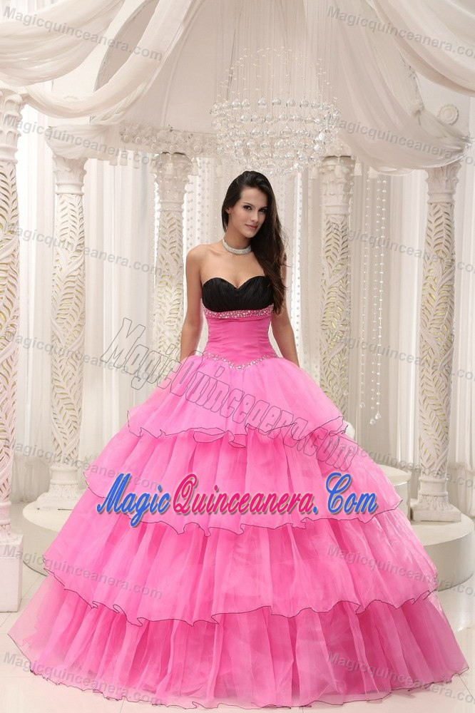 55f6bab719 Rose Pink and Black Sweetheart Quinceanera Dress with Ruffles and Beading