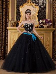 Strapless Black Sweet 16 Dress with Silver Embroidery and a Blue Sash