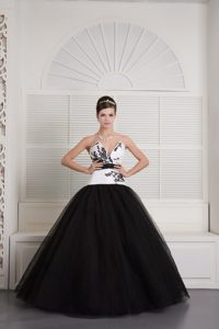 V-neck Black and White Quinceanera Dress with Embroidery and a Black Sash