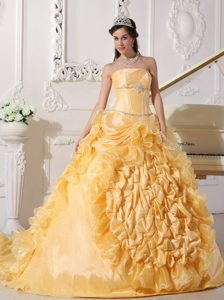 Strapless Gold Quinceanera Dress with Ruffles and a Chapel Train