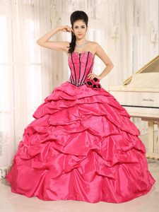 Beaded Flowers Pick Us Dresses for a Quinceanera in Hot Pink