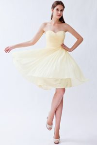 Ruched and Pleated Sweetheart Light Yellow Quinceanera Dama Dress