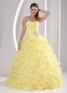 Ruched Light Yellow Sweet 15 Dresses with Beading and Ruffled Layers
